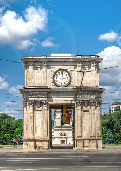Chisinau Moldova – 06.28.2019. Triumphal arch in the center of Chisinau capital of Moldova on a sunny summer day photo