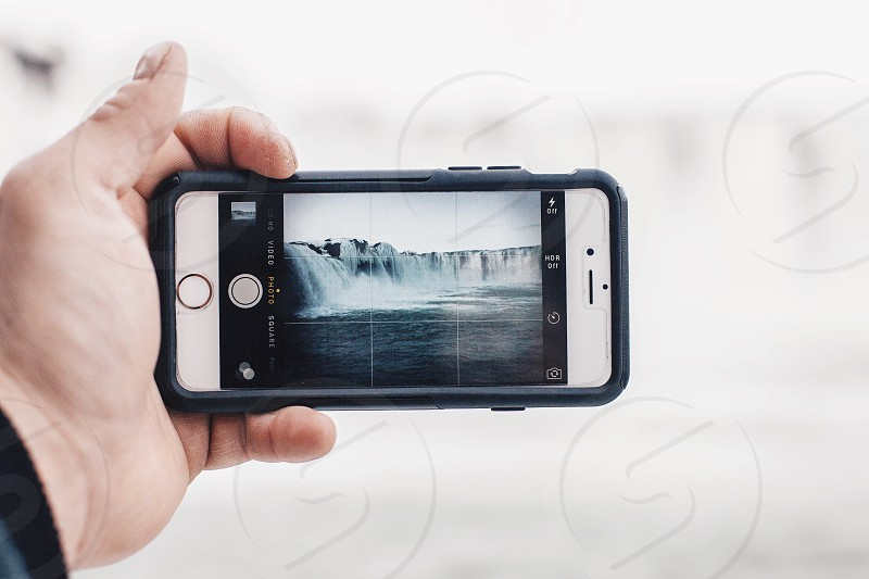 person holding silver iPhone 6 photo