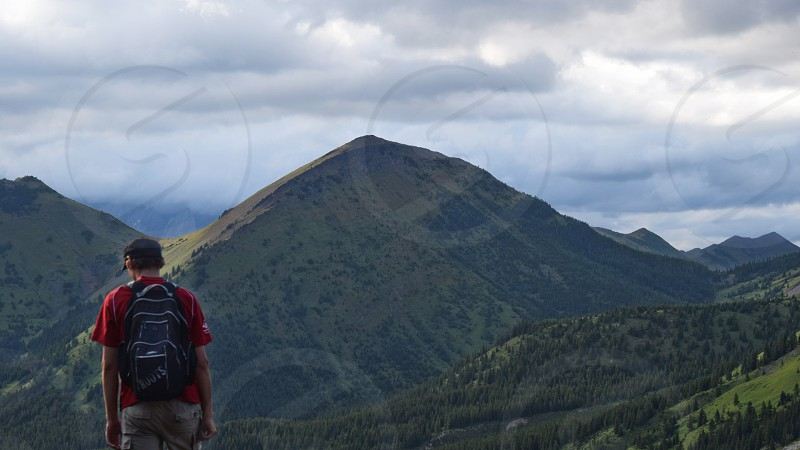 A hiker stands out in front of a beautiful view  photo