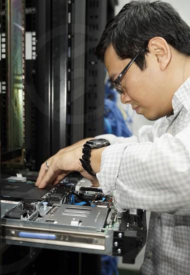 IT guy fixing a server photo