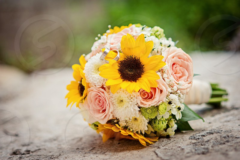 Close up view of a wedding bouquet from sunflowers photo