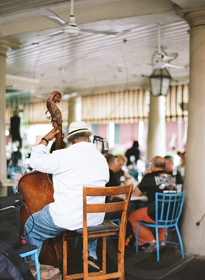 New Orleans live music outdoor venue hat cool musician old microphone vocals singing performance  photo