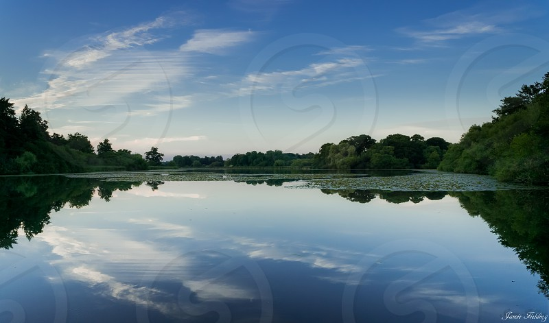 Pond lake water evening clouds reflection still calm peaceful tranquility summer Sussex photo