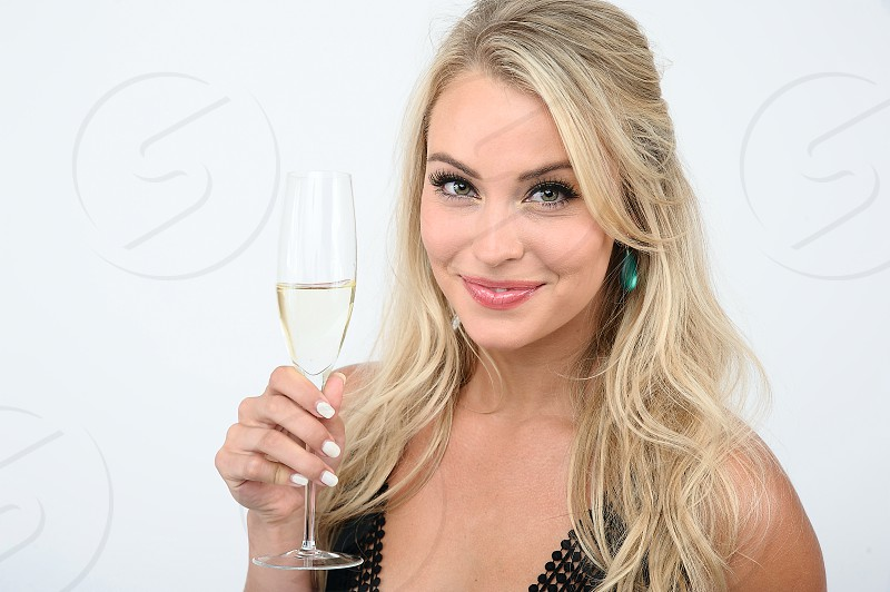 Pretty blond girl holding champagne glass. photo