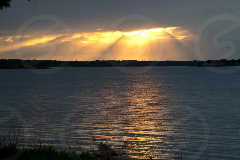 body of water under sunset photo