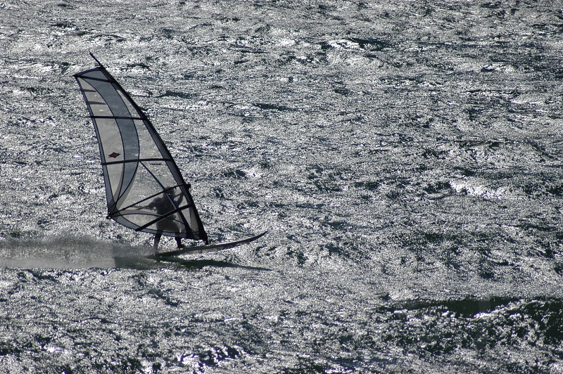 person parasailing on ocean water photo