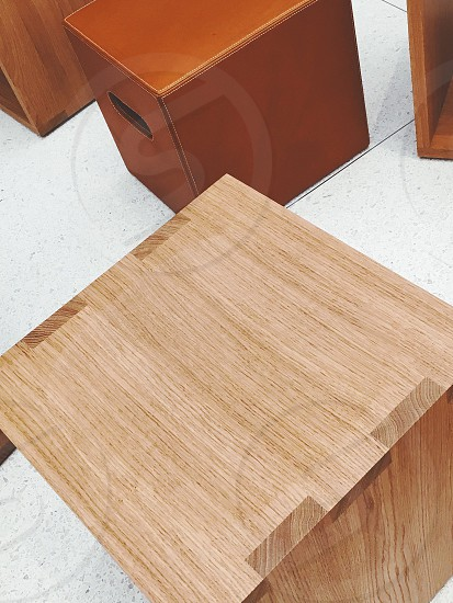 brown wooden square table near brown rectangular container on white tile flooring photo