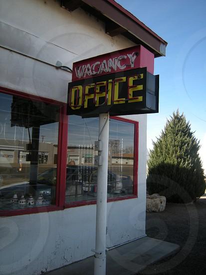 Motel Office Vacancy sign neon daytime photo