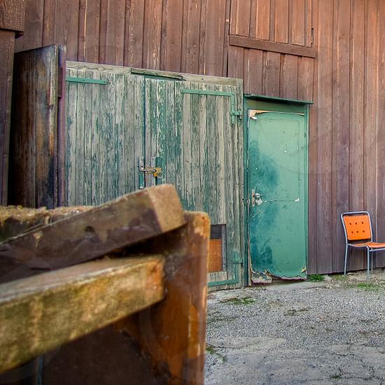 barn door chair wood green orange photo