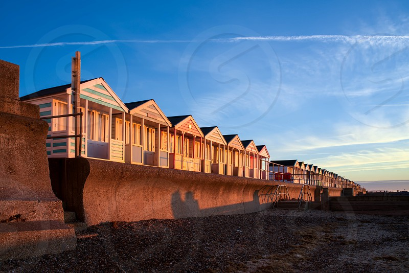 A Row of Brightly Coloured Beach Huts in Southwold photo