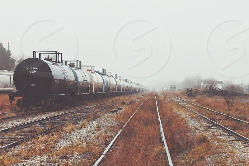 Abandoned train yard on a foggy morning. photo