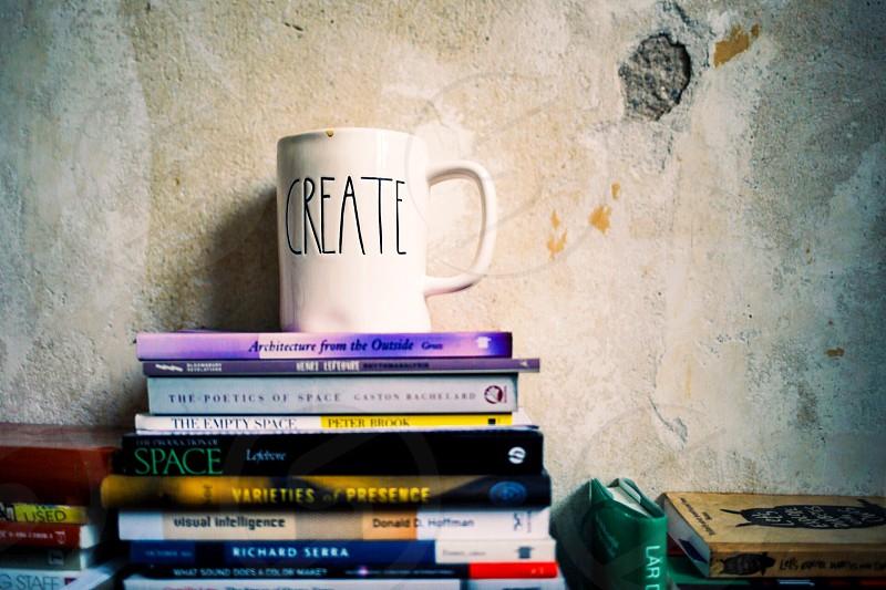 Renter room create pile books wall mug coffee reader space photo