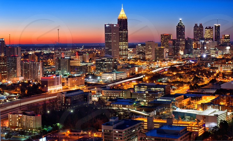 The city of Atlanta at sunrise from the top of the Midtown Atlantic. photo