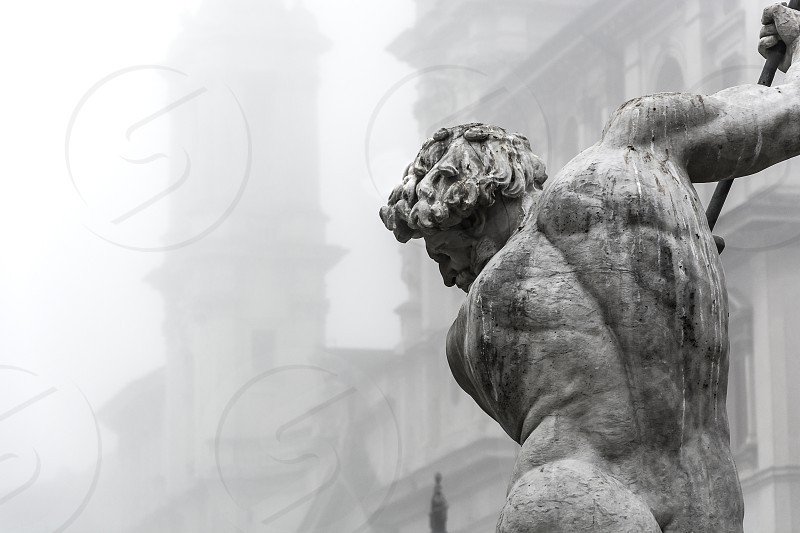 fog rome neptune; fountain; sculpture; statue; marble; navona; italy; tourism; winter; baroque; calderari; travel; architecture; profile; foggy; back; fall photo