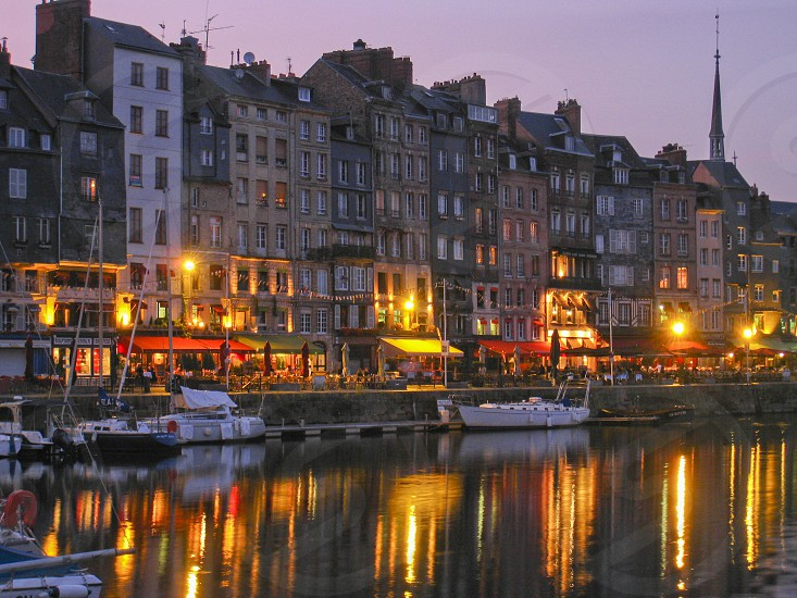 The harbor in Honfleur France at sunset. photo