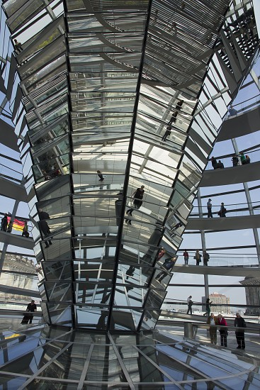 Interior of the Seat of German Parliament  with gigantic mirror and German flag Reichstag building - Berlin photo