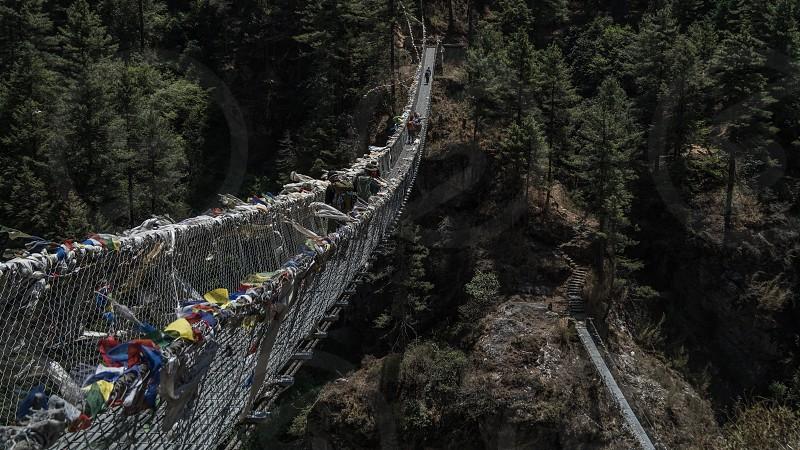 Suspension bridge over the river in Nepal. Everest Base Camp trek. photo