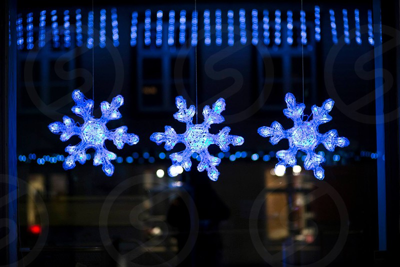 Snowflake lighting on the window of a restaurant in Reykjavik Iceland.  photo