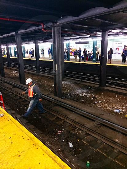 Man o the tracks NYC subway tracks train construction photo