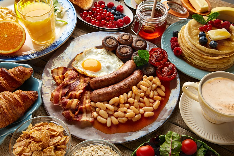 Breakfast buffet full continental and english coffee orange juice salad croissant fruit photo
