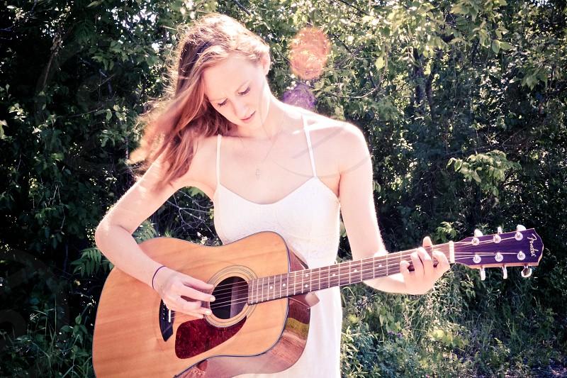 playing guitar young woman guitar outdoors photo