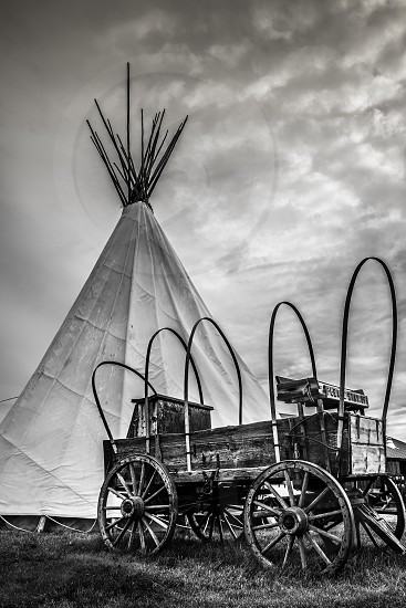 A simpler time. A piece of the Wild West still holds up at Dornan's Moose Chuckwagon near Jackson Hole Wyoming under the majestic Grand Teton Mountains. photo