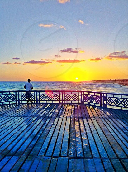 Beach beautiful amazing sun sunset good feeling fun great view blue yellow sea enjoying wood floor photo