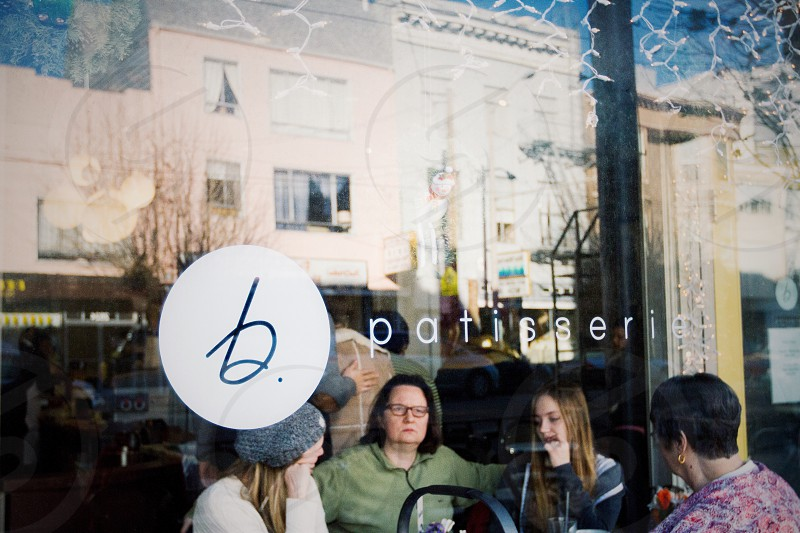 people inside patisserie sitting on chairs photo