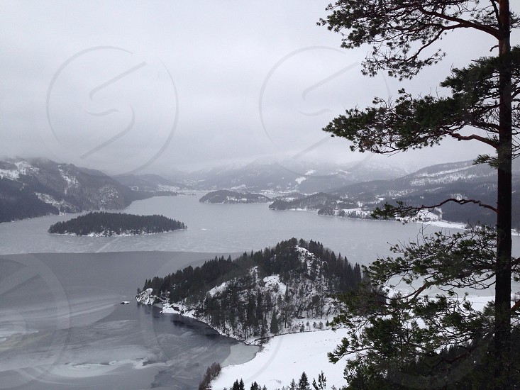 A view of a lake and snow covered mountains in winter in Norway. photo