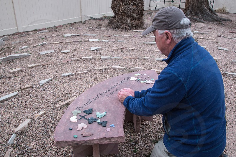 Meditation in prayer labrinth made of stones. photo