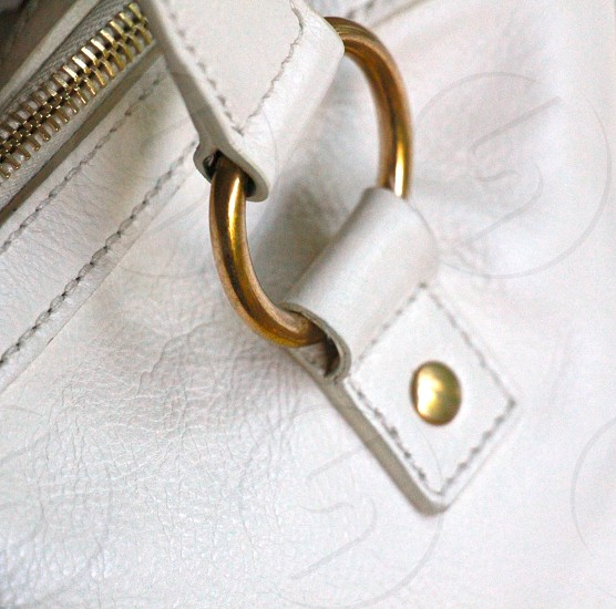white and gold leather bag in macro lens photography photo