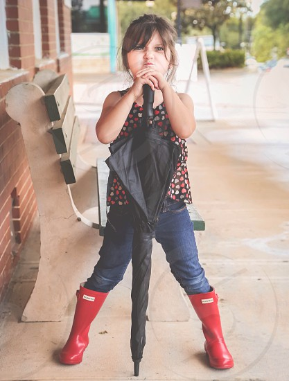 girl standing holding a umbrella photo