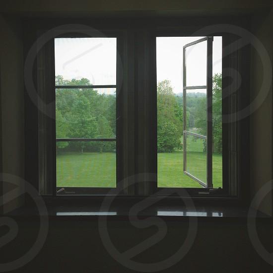white metal framed glass window photo