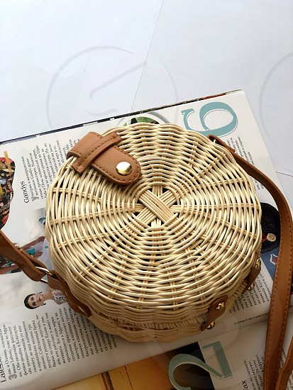 Women's round woven yellow-brown bag . Everything will return: the past and the future. photo