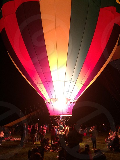 crowd of people near hot air balloon photo