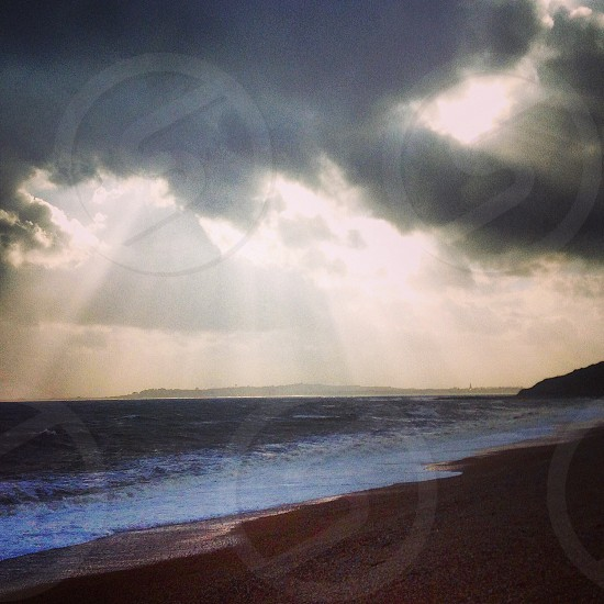 Sun-ray stormy sea waves respite  photo