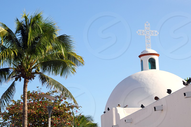 Playa del Carmen white Mexican church with archs and belfry in Mayan Riviera Mexico photo