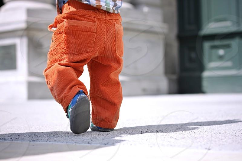 child toddler step walk corduroy orange photo