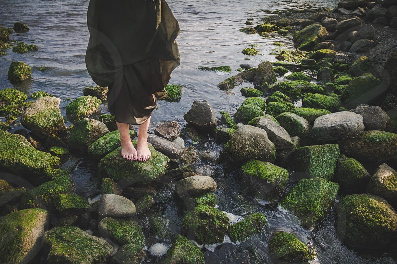 woman standing on green rock photo