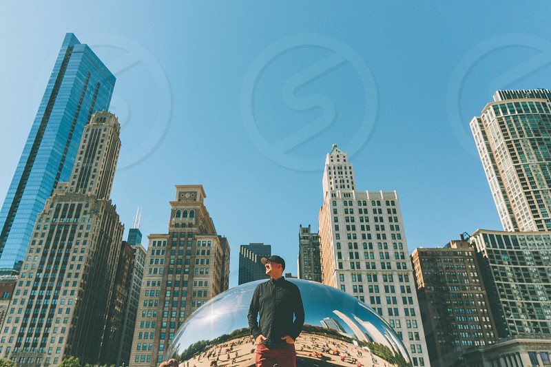 A man looking into the distance standing in front of an iconic Chicago skyline.  photo
