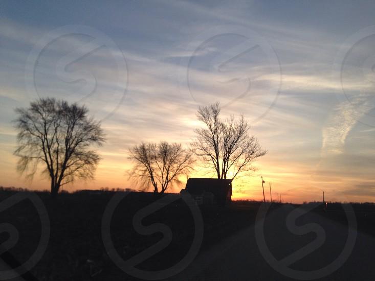 Sunrise over barn  photo