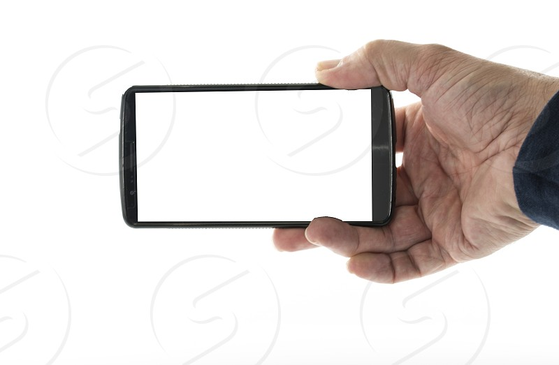 Image of male hand holding smartphone with screen isolated ready for insertion of your application or screenshot photo