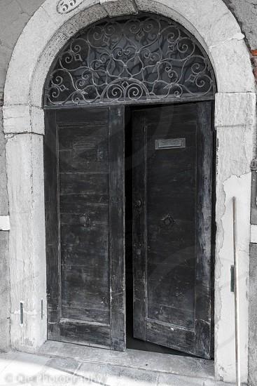 black wooden door is open photo