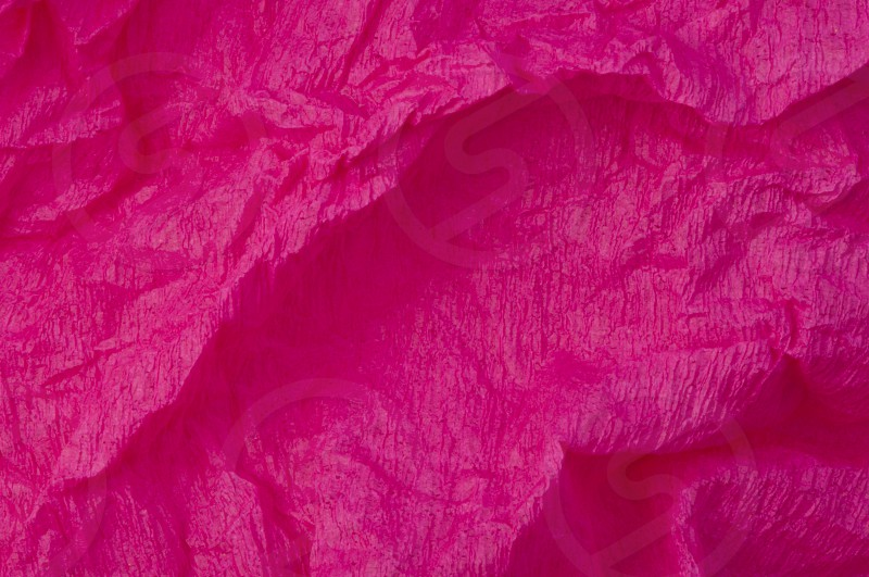 Background of pink old crumpled paper photo