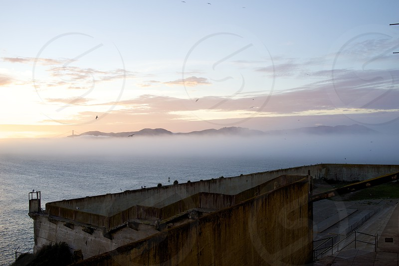 view of an island across a foggy ocean  photo