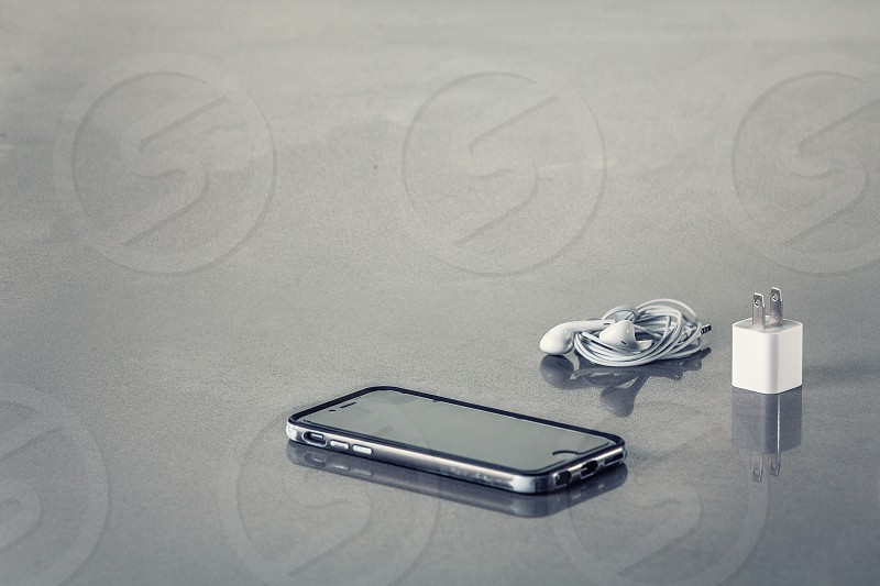Iphone cellphone cell charger headphones text space room for body electronics phone wires apple photo