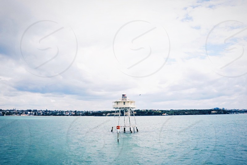 Lighthouse water ocean float New Zealand pacific sea light white blue  photo