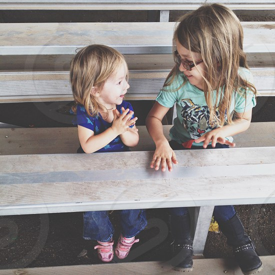 two girls playing in bleachers photo
