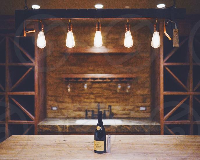 wine bottle on wooden table photo