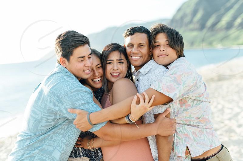 Family squish love hugs beach photo